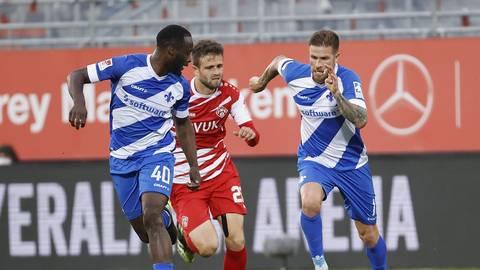 Der Einsatz von Erich Berko (links) am Freitag im Auswärtsspiel der Lilien in Hannover ist ebenso gefährdet wie der von Tobias Kempe (rechts).  Foto: Joaquim Ferreira
