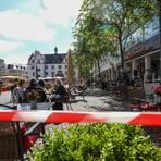 Abstand und Absperrband gehören zum Alltag: Gastronomie auf dem Darmstädter Marktplatz.Foto: Guido Schiek