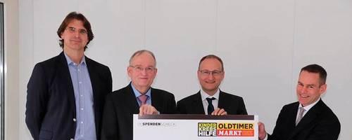 425 000 Euro für die Universitätskliniken Mainz und Gießen: Prof. Stefan Gattenlöhner (Gießen), Prof. Dieter Körholz (Gießen), Prof. Jörg Faber (Mainz) und Dr. Olaf Theisen (von links). Foto: Oldtimer Markt