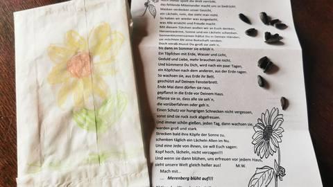 Mit einem Gedicht und einigen Sonnenblumen-Samen sorgen die Kita-Kinder des Marktflecken Merenberg derzeit für viele lächelnde Gesichter.  Foto: Marion Weber