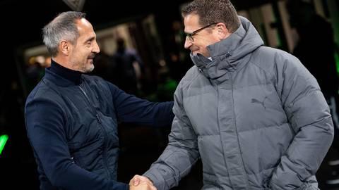 Am Samstag Gegner, ab Sommer Partner: Eintracht-Coach Adi Hütter (links) sagt Gladbachs Sportdirektor Max Eberl zu. Foto: dpa