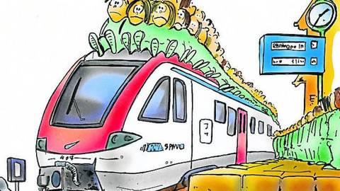 Die Vias-Züge auf der Rheingau-Linie sind nicht nur zu Stoßzeiten überfüllt, kritisieren Pendler. Cartoon: Archiv/Schwarze-Blanke