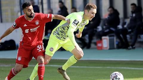 SVWW-Spieler Marc Lais im Laufduell mit Bayern Sarpreet Singh. Foto: Paul Kufahl/rscp-photo